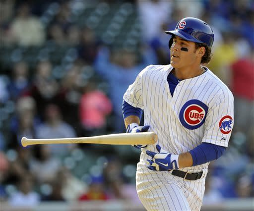 Chicago Cubs' Anthony Rizzo tosses his bat after flying out against the Cincinnati Reds during the 11th inning of a baseball game on Thursday, June 13, 2013, in Chicago. (AP Photo/Jim Prisching)
