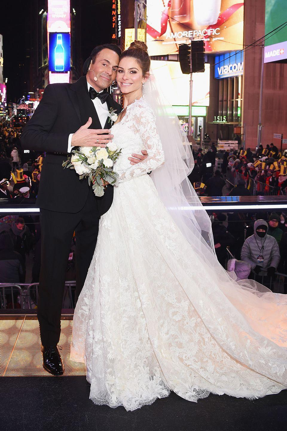 """<p>Maria Menounos got married to her longtime beau Kevin Undergaro on New Year's Eve in a surprise ceremony in Times Square! Her long-sleeved <span class=""""redactor-unlink"""">Atelier Pronovias mermaid gown</span> was classically chic (and hopefully the long sleeves kept her warm).</p>"""