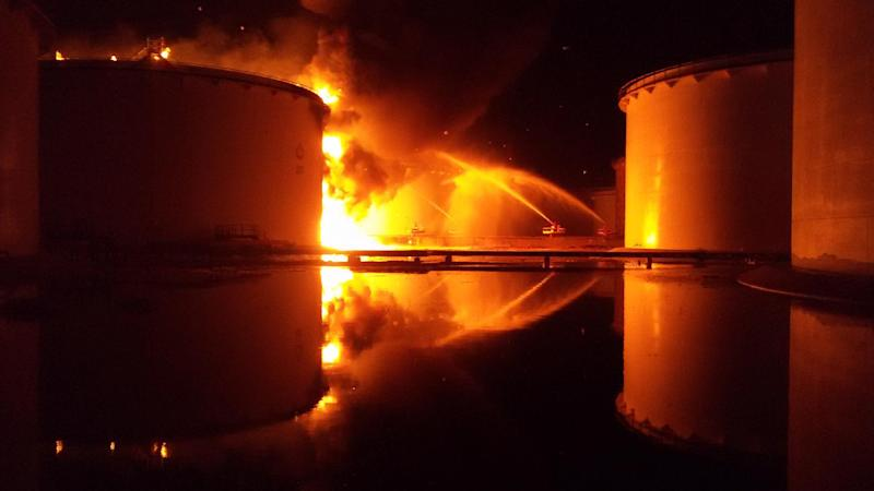 Libyan firefighters douse a huge blaze at an oil tank started by clashes around Tripoli airport on July 28, 2014 (AFP Photo/Mohamed Elbosifi)