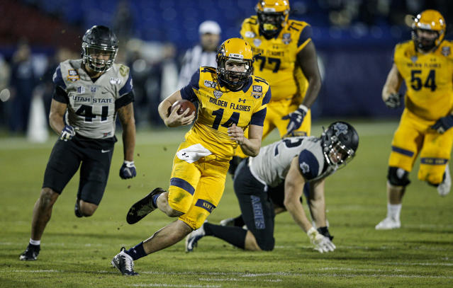 Kent State quarterback Dustin Crum (14) carries the ball during the second half of the team's Frisco Bowl NCAA college football game against Utah State on Friday, Dec. 20, 2019, in Frisco, Texas. Kent State won 51-41. (AP Photo/Brandon Wade)