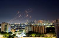 Streaks of light are seen from Ashkelon as Israel's Iron Dome anti-missile system intercepts rockets launched from the Gaza Strip towards Israel