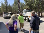 Linda Jincks and her husband Rodger talk with driller Shane Harris as his crew drills a new well for the Jincks at their home in La Pine, Ore., on Aug. 26, 2021. Sheriff's deputies busted an illegal marijuana grow a block away recently and another, bigger grow had been nearby, using water from the same aquifer that the neighborhood uses. (AP Photo/Andrew Selsky)