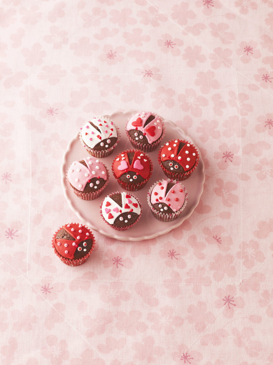 """<p>There's no sweeter holiday than Valentine's Day. Beyond the heartfelt love notes and sentimental gifts, it's an occasion packed with literal sweetness, all thanks to <a href=""""https://www.goodhousekeeping.com/holidays/valentines-day-ideas/g1409/best-valentines-day-chocolates/"""" rel=""""nofollow noopener"""" target=""""_blank"""" data-ylk=""""slk:boxes of chocolates"""" class=""""link rapid-noclick-resp"""">boxes of chocolates</a>,<a href=""""https://www.goodhousekeeping.com/food-recipes/dessert/a34865114/heart-shaped-cake-recipe/"""" rel=""""nofollow noopener"""" target=""""_blank"""" data-ylk=""""slk:heart-shaped cakes"""" class=""""link rapid-noclick-resp""""> heart-shaped cakes</a>, or a medley of red and pink candies. But if you're on the hook to whip up a batch of festive baked goods for your kid's Valentine's Day party at school or simply in need of an easy, edible gift for your loved ones, try your hand at one of these Valentine's Day cupcakes this year. Browse through these Cupid-approved <a href=""""https://www.goodhousekeeping.com/food-recipes/dessert/g2411/cupcake-ideas/"""" rel=""""nofollow noopener"""" target=""""_blank"""" data-ylk=""""slk:cupcake recipes"""" class=""""link rapid-noclick-resp"""">cupcake recipes</a> to find a delectable flavor that'll satisfy your valentine's tastebuds, whether they have their heart set on chocolate, strawberries, or a blend of the two. But if you're looking to get crafty in the kitchen, opt for one of the more extravagant decoration ideas, like chocolate cupcakes that can be transformed into adorable lovebugs with red, pink, and white frosting. </p><p>Cupcakes may be the centerpiece on your dessert table, but make sure you round out your holiday spread with other <a href=""""https://www.goodhousekeeping.com/holidays/valentines-day-ideas/g3180/valentines-desserts/"""" rel=""""nofollow noopener"""" target=""""_blank"""" data-ylk=""""slk:Valentine's Day desserts"""" class=""""link rapid-noclick-resp"""">Valentine's Day desserts</a>, including brownies, cookies, and other <a href=""""https://www.goodhousekeeping.com/holidays/valentines"""