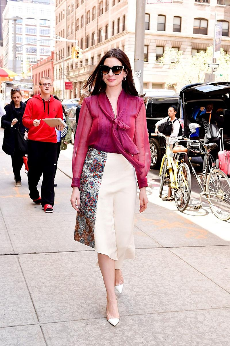 Anne Hathaway put some old clothes to good use, wearing a vintage YSL blouse and secondhand Stella McCartney asymmetrical skirt for her appearance on The View.