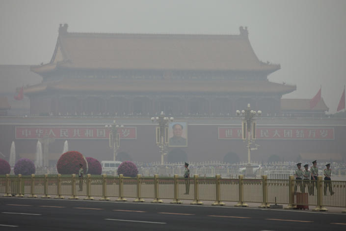 <p> In this Sunday June 2, 2013 photo, paramilitary policemen patrol on Tiananmen Square on a polluted day in Beijing, China. China's Cabinet has announced Friday, June 15, 2013 measures to curb the country's notorious air pollution, one of the many environmental challenges facing the country that are increasingly angering the public. (AP Photo/Alexander F. Yuan)</p>