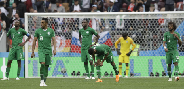 Saudi Arabia teammates react after losing the group A match between Russia and Saudi Arabia which opens the 2018 soccer World Cup at the Luzhniki stadium in Moscow, Russia, Thursday, June 14, 2018. (AP Photo/Matthias Schrader)