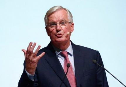 FILE PHOTO - European Union's chief Brexit negotiator Michel Barnier gestures as he delivers a speech at the