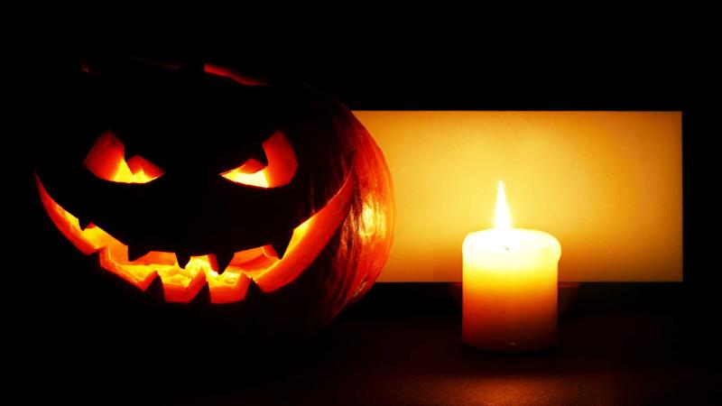 Halloween pumpkin with burning candle