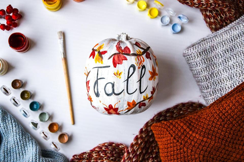<p>Paint your pumpkin any color you'd like and use autumnal hues to create branches and leaves, and then spell out the season. The best part is, you can easily keep this up after Halloween is over. </p>