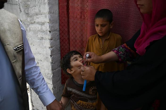 Polio is endemic in only three countries globally -- Pakistan, Afghanistan and Nigeria -- although a relatively rare strain was also detected in Papua New Guinea last year (AFP Photo/AAMIR QURESHI)