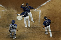 Tampa Bay Rays' Brandon Lowe celebrates his three-run home run against the Los Angeles Dodgers during the sixth inning in Game 4 of the baseball World Series Saturday, Oct. 24, 2020, in Arlington, Texas. (AP Photo/David J. Phillip)