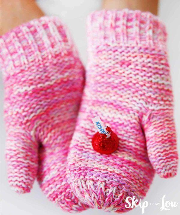"""<p>All you need is a pair of big, chunky mittens and a bag of Hershey's Kisses for this game. The kids will be roaring with laughter by the end!</p><p><strong>Get the tutorial at <a href=""""https://www.skiptomylou.org/valentine-games/"""" rel=""""nofollow noopener"""" target=""""_blank"""" data-ylk=""""slk:Skip to My Lou"""" class=""""link rapid-noclick-resp"""">Skip to My Lou</a>.</strong></p><p><strong><a class=""""link rapid-noclick-resp"""" href=""""https://www.amazon.com/Hersheys-Kisses-Chocolate-Silver-Pound/dp/B06Y3NF371/?tag=syn-yahoo-20&ascsubtag=%5Bartid%7C10050.g.25916974%5Bsrc%7Cyahoo-us"""" rel=""""nofollow noopener"""" target=""""_blank"""" data-ylk=""""slk:SHOP HERSHEY KISSES"""">SHOP HERSHEY KISSES</a><br></strong></p>"""