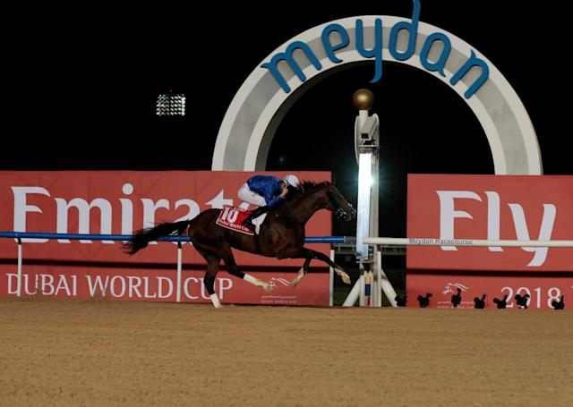 Horse Racing - Dubai World Cup 2018 - Meydan Racecourse, Dubai - United Arab Emirates - March 31, 2018 - Christophe Soumillon rides Thunder Snow from Ireland to the finish line to win the Ninth and Final Race. REUTERS/Christopher Pike