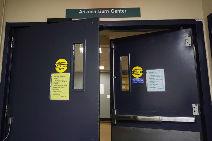 Arizona Burn Center Valleywise Health entrance shown Monday, June 14, 2021, in Phoenix. Emergency rooms like the one at the Arizona Burn Center in Phoenix, where director Dr. Kevin Foster said 104 people were admitted in June, July and August 2020 with serious burn injuries due to contact with hot surfaces. (AP Photo/Ross D. Franklin)