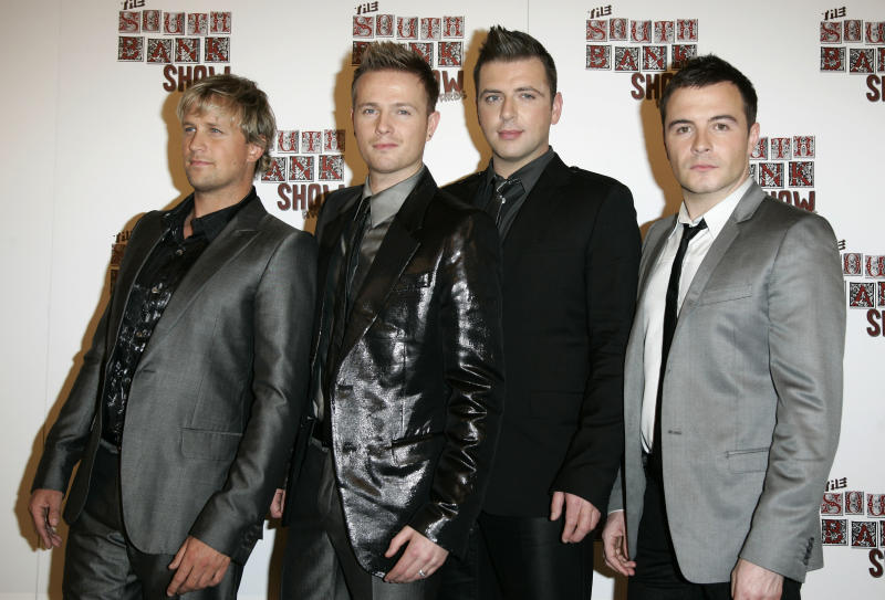 FILE - In this Tuesday, Jan. 29, 2008 file photo members of Irish band Westlife, from left, Kian Egan, Nicky Byrne, Mark Feehily and Shane Filan pose after performing at the South Bank Show Awards in London. After 14 years as one of Ireland's most successful boy bands, Westlife announced their split Thursday Oct. 20, 2011. (AP Photo/Sang Tan, file)