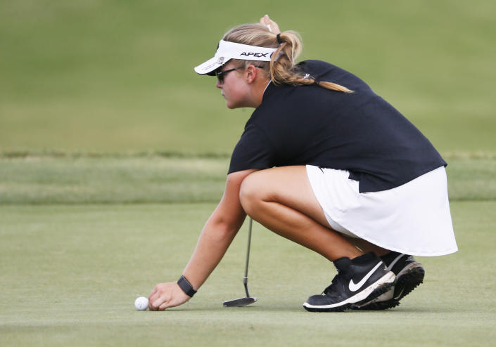 Fourteen-year-old amateur Avery Zweig lines up her putt on the 18th green during the second round of the LPGA Volunteers of America Classic golf tournament in The Colony, Texas, Friday, July 2, 2021. (AP Photo/Ray Carlin)