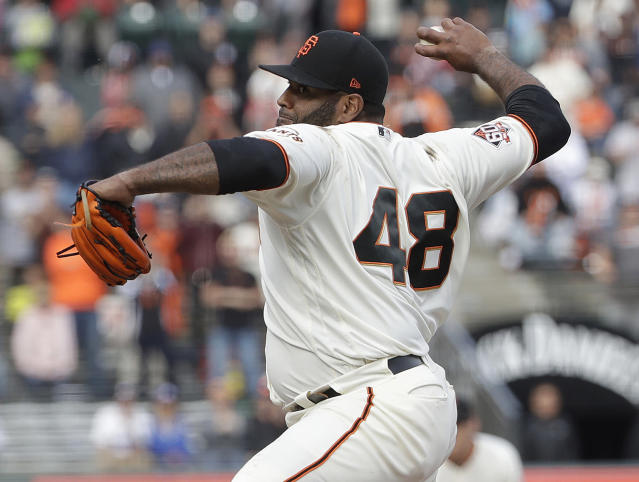 FILE - In this April 28, 2018, file photo, San Francisco Giants' Pablo Sandoval pitches against the Los Angeles Dodgers during the ninth inning of a baseball game in San Francisco. Pablo Sandoval made his debut on the mound this season. So have infielders Jose Reyes and Anthony Rizzo. The use of position players has become an increasing trend in baseball this season, especially in blowouts to save wear and tear on the bullpen. (AP Photo/Jeff Chiu, File)