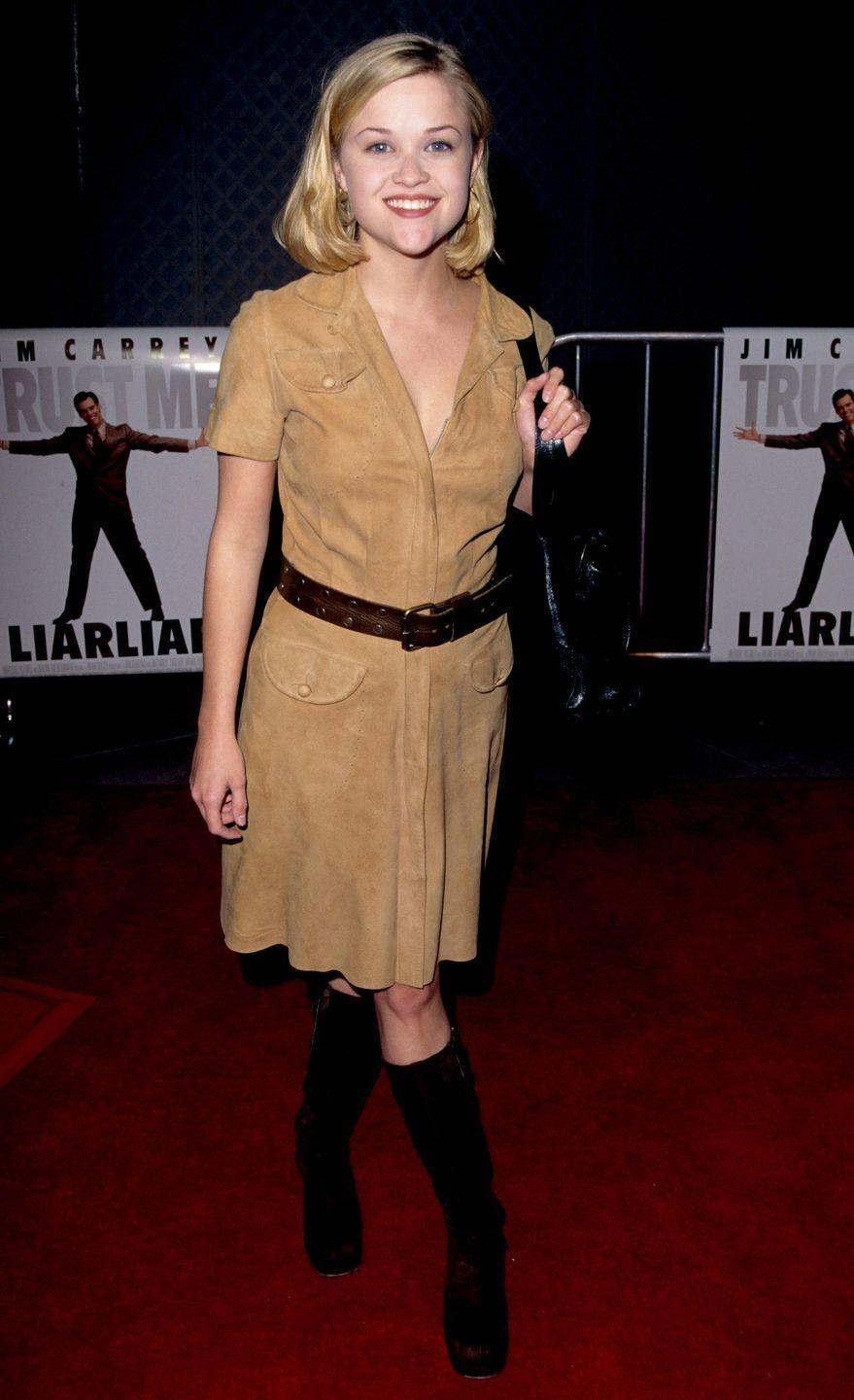 <p>Witherspoon channeled safari style in a suede shirt dress and knee-high boots. </p>
