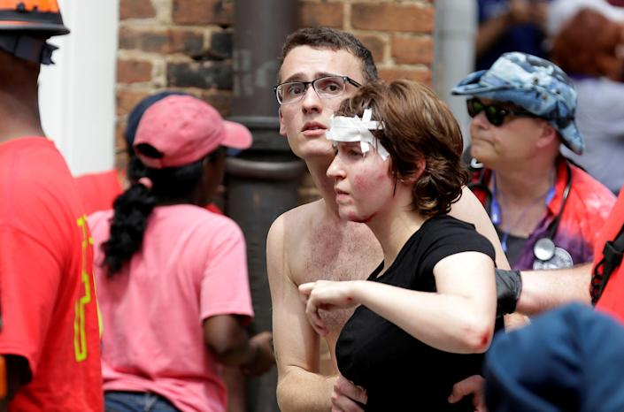"""<p>A woman who was injured when a car drove through a group of counter protestors at the """"Unite the Right"""" rally is helped in Charlottesville, Virginia, U.S., Aug. 12, 2017. (Photo: Joshua Roberts/Reuters) </p>"""