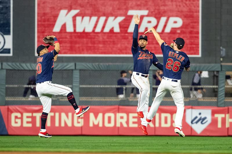 MINNEAPOLIS, MN - SEPTEMBER 07: Eddie Rosario #20, Byron Buxton #25 and Max Kepler #26 celebrate against the Cleveland Indians on September 7, 2019 at the Target Field in Minneapolis, Minnesota. The Twins defeated the Indians 5-3. (Photo by Brace Hemmelgarn/Minnesota Twins/Getty Images)