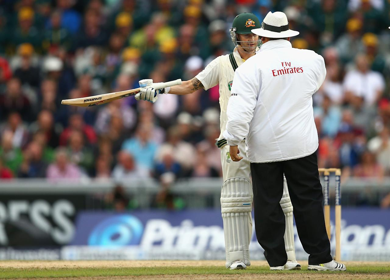 MANCHESTER, ENGLAND - AUGUST 04:  Michael Clarke of Australia speaks to Umpire Marias Erasmus after bad light stopped play during day four of the 3rd Investec Ashes Test match between England and Australia at Emirates Old Trafford Cricket Ground on August 4, 2013 in Manchester, England.  (Photo by Ryan Pierse/Getty Images)
