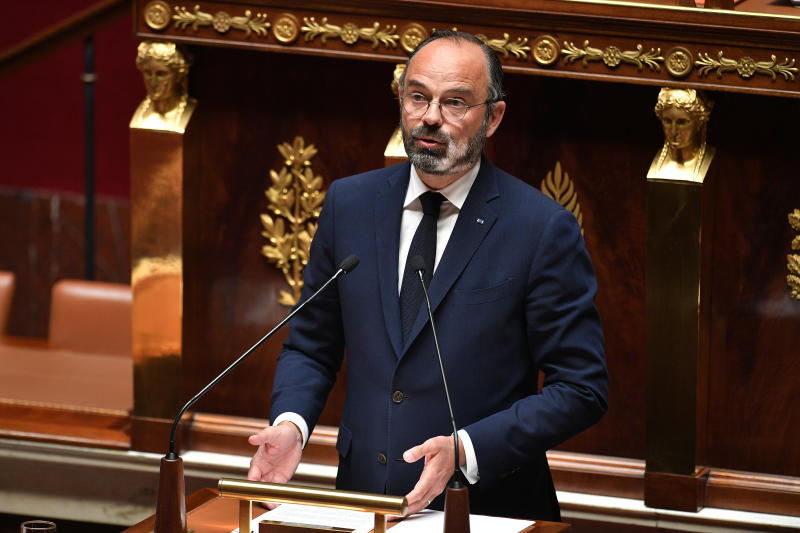 French Prime Minister Edouard Philippe presents his plan to exit from the lockdown at the National Assembly in Paris, Tuesday, April 28, 2020. French Prime Minister Edouard Philippe unveils a plan to parliament Tuesday on how the country will gradually re-open schools, stores and some other businesses. (David Niviere, Pool via AP)