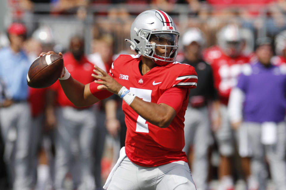 Ohio State quarterback C.J. Stroud drops back to pass against Oregon during the first half of an NCAA college football game Saturday, Sept. 11, 2021, in Columbus, Ohio. (AP Photo/Jay LaPrete)