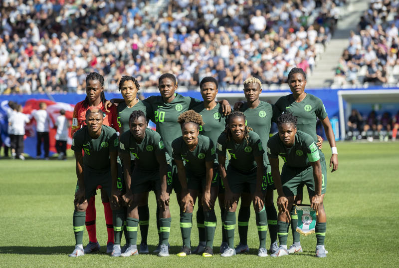 GRENOBLE, FRANCE - JUNE 22: Team of Nigeria poses for a group photo during the 2019 FIFA Women's World Cup France Round Of 16 match between Germany and Nigeria at Stade des Alpes on June 22, 2019 in Grenoble, France. (Photo by Maja Hitij/Getty Images)