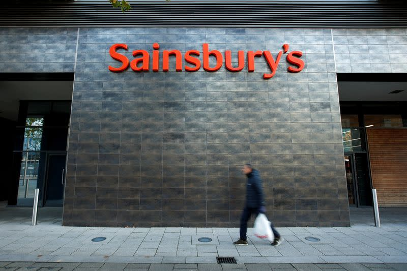 A person walks past a Sainsbury's store in Milton Keynes