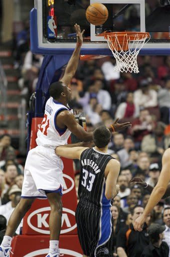 Philadelphia 76ers' Thaddeus Young (21) shoots past Orlando Magic's Ryan Anderson (33) in the first half of an NBA basketball game, Monday, Jan. 30, 2012, in Philadelphia. The 76ers won 74-69. (AP Photo/H. Rumph Jr )