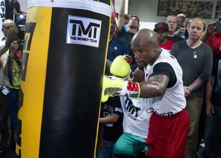 WBC welterweight champion Floyd Mayweather Jr. of the U.S. hits a punching bag during a media workout at the Mayweather Boxing Club in Las Vegas