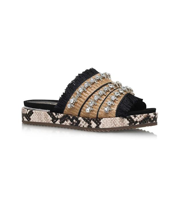 "<p>Melba Slide Sandals, $114, <a href=""http://us.asos.com/kg-kurt-geiger/kg-by-kurt-geiger-melba-slide-sandals/prd/7692693?iid=7692693&clr=Beige&SearchQuery=flats&pgesize=36&pge=2&totalstyles=193&gridsize=3&gridrow=9&gridcolumn=1"" rel=""nofollow noopener"" target=""_blank"" data-ylk=""slk:asos.com"" class=""link rapid-noclick-resp"">asos.com</a> </p>"