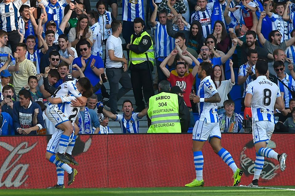 Real Sociedad's players celebrate at the end of the Spanish League football match between Real Sociedad and Real Madrid at the Anoeta Stadium in San Sebastian.
