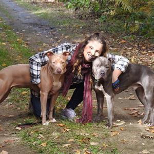 Heidi Curtis, pictured with her two rescued dogs, Apollo and Aphrie.