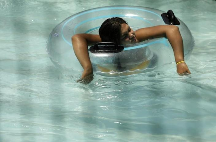 PALMDALE, CA - JULY 11, 2021 - - BEAT BY THE HEAT - - A young woman cools off at Dry Town Water Park where temperatures reached 108 degrees by 3 p.m. in Palmdale on Sunday on July 11, 2021. (Genaro Molina / Los Angeles Times)