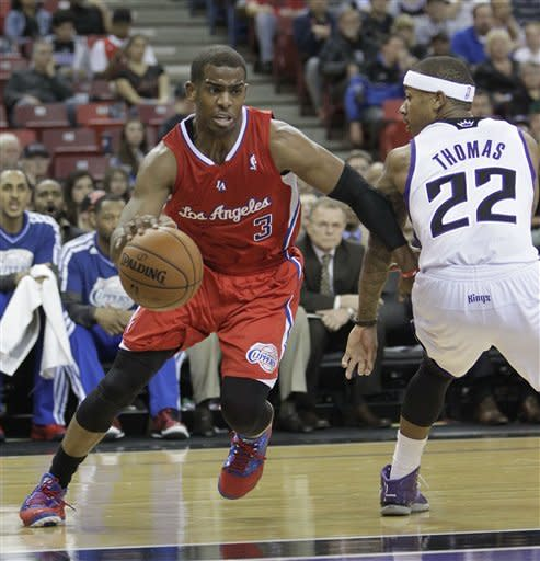 Los Angeles Clippers guard Chris Paul, left, drives past Sacramento Kings guard Isaiah Thomas during the first quarter of an NBA basketball game in Sacramento, Calif., Tuesday, March 19, 2013.(AP Photo/Rich Pedroncelli)