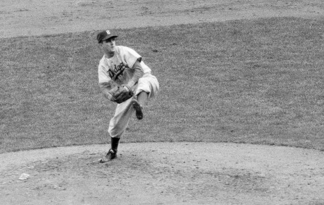 "FILE - In this October 1952 file photo, Brooklyn Dodgers' Carl Erskine pitches against the New York Yankees in Game 5 of the baseball World Series in New York. Up by 13 1/2 games in mid-August in 1951, Jackie Robinson and the Dodgers seemed destined. That was until rookie Willie Mays and the New York Giants came flying back, fueled by an incredible, late run in home games at the Polo Grounds, and forced a best-of-three playoff for the National League pennant. Erskine was warming up in the Brooklyn bullpen in Game 3 when Bobby Thomson connected for the famed ""Shot Heard 'Round the World,"" a three-run homer in the bottom of the ninth off Ralph Branca that rallied the Giants to a 5-4 win. A half-century later, a giant secret was revealed: The Giants had rigged a spyglass-and-buzzer system in late July to steal catchers' signals and tip off their hitters. (AP Photo, File)"