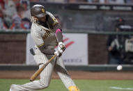 San Diego Padres' Fernando Tatis Jr. hits a two-run home run against the San Francisco Giants during the first inning of the second game of a baseball doubleheader Friday, Sept. 25, 2020, in San Francisco. (AP Photo/Tony Avelar)