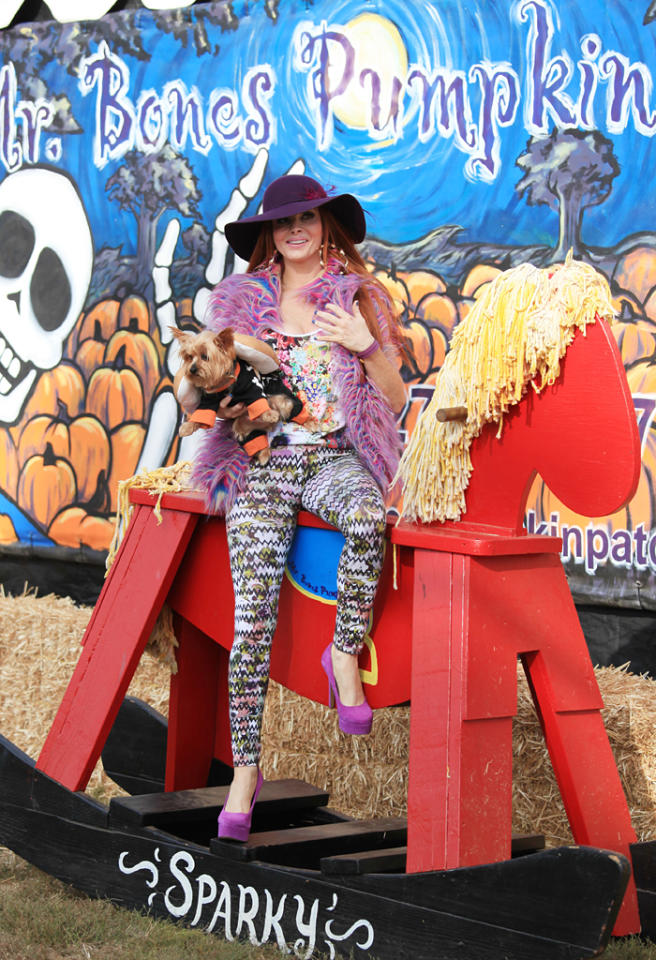 "Even though celebutante Phoebe Price is essentially a nobody, she knows she can always count on attracting some snaps at Mr. Bones. As usual, she donned a garish outfit while posing with her costumed pooch and a giant wooden horse. (10/6/2012)<br><div style=""display:none;"" class=""skype_pnh_menu_container""><div class=""skype_pnh_menu_click2call""><a class=""skype_pnh_menu_click2call_action"">Call</a></div><div class=""skype_pnh_menu_click2sms""><a class=""skype_pnh_menu_click2sms_action"">Send SMS</a></div><div class=""skype_pnh_menu_add2skype""><a class=""skype_pnh_menu_add2skype_text"">Add to Skype</a></div><div class=""skype_pnh_menu_toll_info""><span class=""skype_pnh_menu_toll_callcredit"">You'll need Skype Credit</span><span class=""skype_pnh_menu_toll_free"">Free via Skype</span></div></div>"