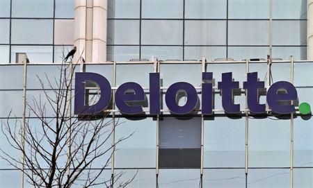The Deloitte Company logo is seen on a commercial tower at Gurgaon, on the outskirts of New Delhi
