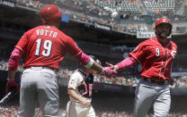 Cincinnati Reds' Jose Peraza, right, is congratulated by Joey Votto after scoring a run against the San Francisco Giants during the second inning of a baseball game in San Francisco, Sunday, May 12, 2019. (AP Photo/Jeff Chiu)