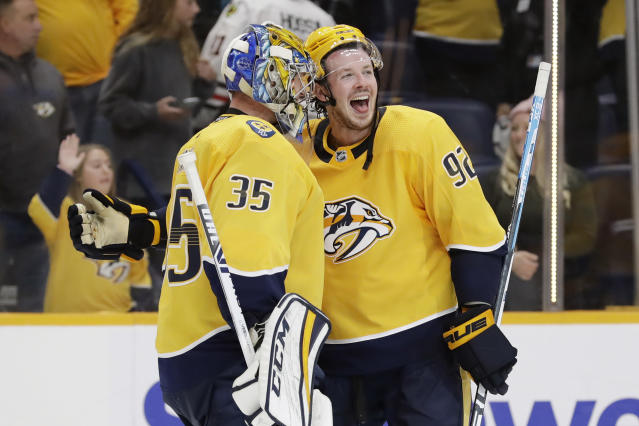 Nashville Predators center Ryan Johansen (92) celebrates with goaltender Pekka Rinne (35), of Finland, after an NHL hockey game between the Predators and the Chicago Blackhawks on Tuesday, Oct. 29, 2019, in Nashville, Tenn. The Predators won 3-0. (AP Photo/Mark Humphrey)
