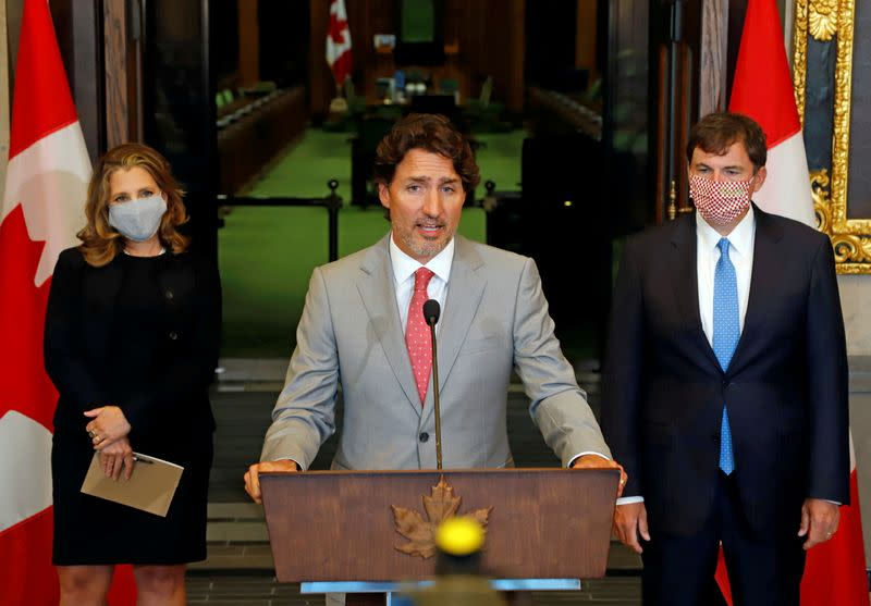 FILE PHOTO: Canadian Prime Minister Trudeau speaks to reporters next to Canadian Deputy Prime Minister and Finance Minister Freeland and Minister of Intergovernmental Affairs LeBlanc on Parliament Hill in Ottawa