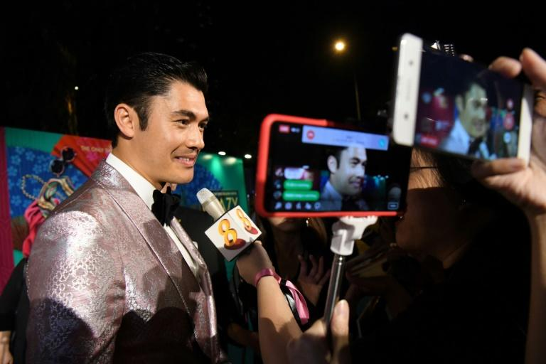 British-Malaysian actor Henry Golding, who stars as Nick Young in Crazy Rich Asians, attends the Singapore premiere of the movie on Wednesday