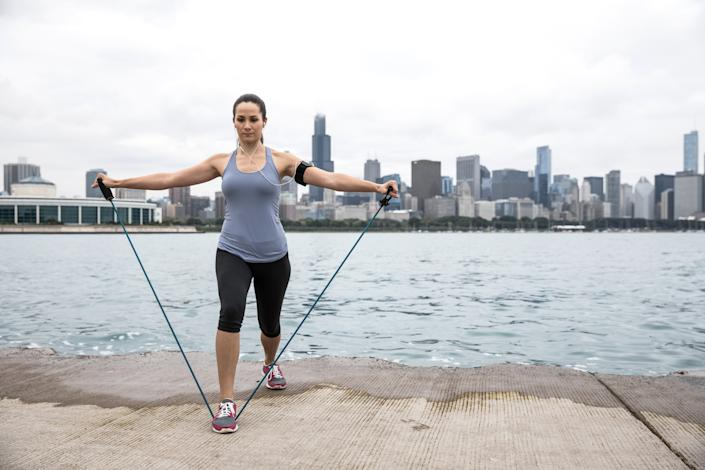 Resistance bands are an easy way to tone muscle without access to a gym. (Image via Getty Images)