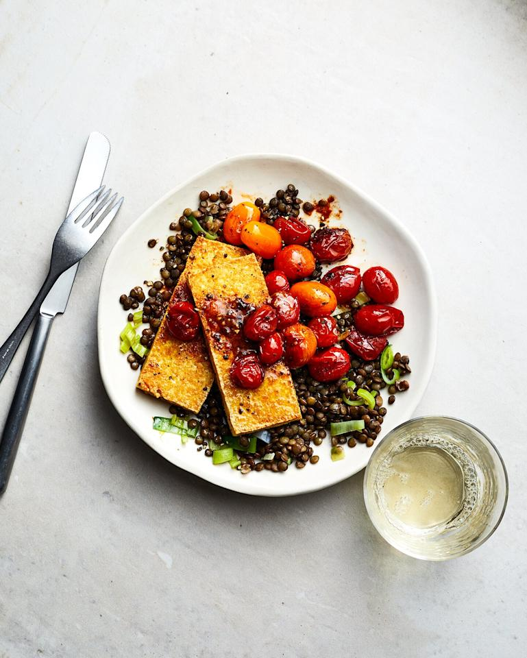 """<p><a href=""""https://www.realsimple.com/food-recipes/recipe-collections-favorites/popular-ingredients/what-is-nutritional-yeast"""" target=""""_blank"""">Nutritional yeast</a> (sometimes referred to as """"nooch"""") is common in vegan and vegetarian dishes as a stand-in for cheese, thanks to its savory, umami-rich flavor. Like parm, it tastes delicious when sprinkled on everything from popcorn and baked potatoes to roasted cauliflower, kale salad, and pasta. The difference between them? Unlike parmesan cheese, nutritional yeast is packed with B vitamins, protein, minerals, and antioxidants. </p> <p><strong>Try: </strong>This recipe for <a href=""""https://www.realsimple.com/food-recipes/browse-all-recipes/tofu-halloumi-with-lentils-and-burst-tomatoes"""" target=""""_blank"""">Tofu """"Halloumi"""" With Lentils and Burst Tomatoes</a>.</p>"""