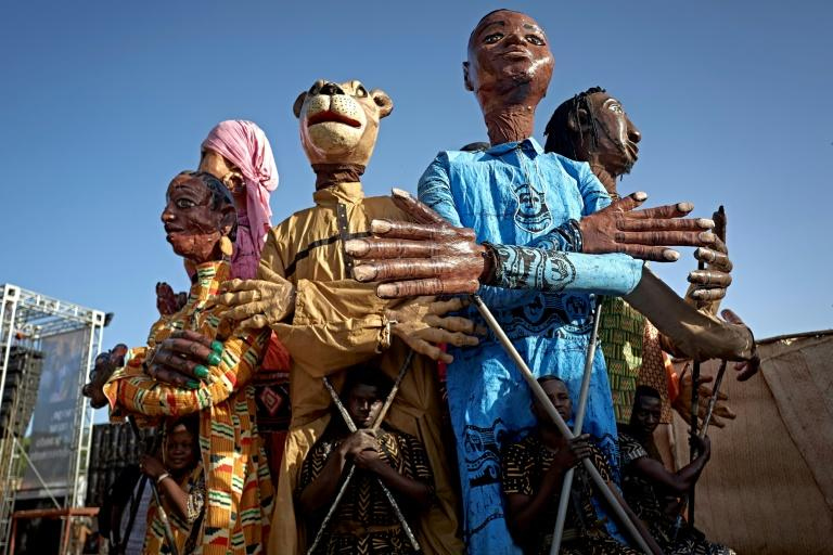 Dancers perform with traditional puppets of Mali's Segou region