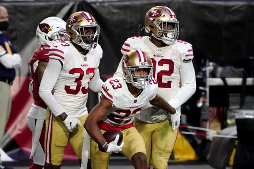 San Francisco 49ers cornerback Ahkello Witherspoon (23) celebrates his interception against the Arizona Cardinals during the second half of an NFL football game, Saturday, Dec. 26, 2020, in Glendale, Ariz. (AP Photo/Rick Scuteri)