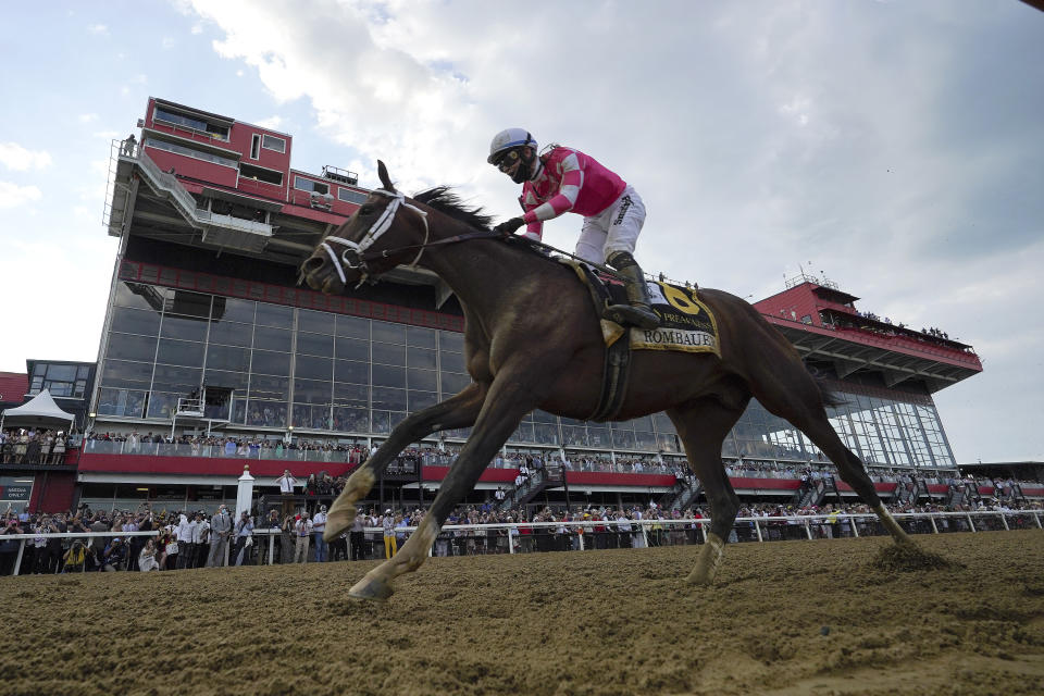 Flavien Prat atop Rombauer crosses the finish line to win the Preakness Stakes horse race at Pimlico Race Course, Saturday, May 15, 2021, in Baltimore. (AP Photo/Julio Cortez)