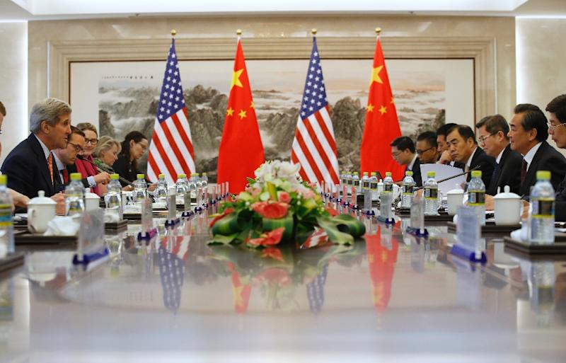 US Secretary of State John Kerry (L) holds a meeting with Chinese Foreign Minister Wang Yi (R) during their meeting at the Ministry of Foreign Affairs in Beijing on May 16, 2015 (AFP Photo/Kim Kyung-Hoon)